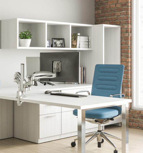 Kontour monitor arms are used here in this private office to eliminate the cords and clutter that can typically be seen.