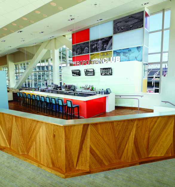Behind the Metro Club bar at Target Field, you can find Chief products to affix the tvs to the wall for guests seated in the space.