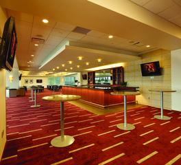 Chief TCF Stadium Club Corridor bar high top table area