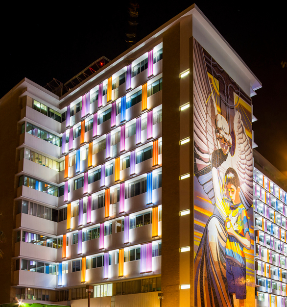 The vibrant channel glass colors, visible from a distance in the day or night, were inspired by the hospital's logo and a multi-story art mural gracing one of its facades.