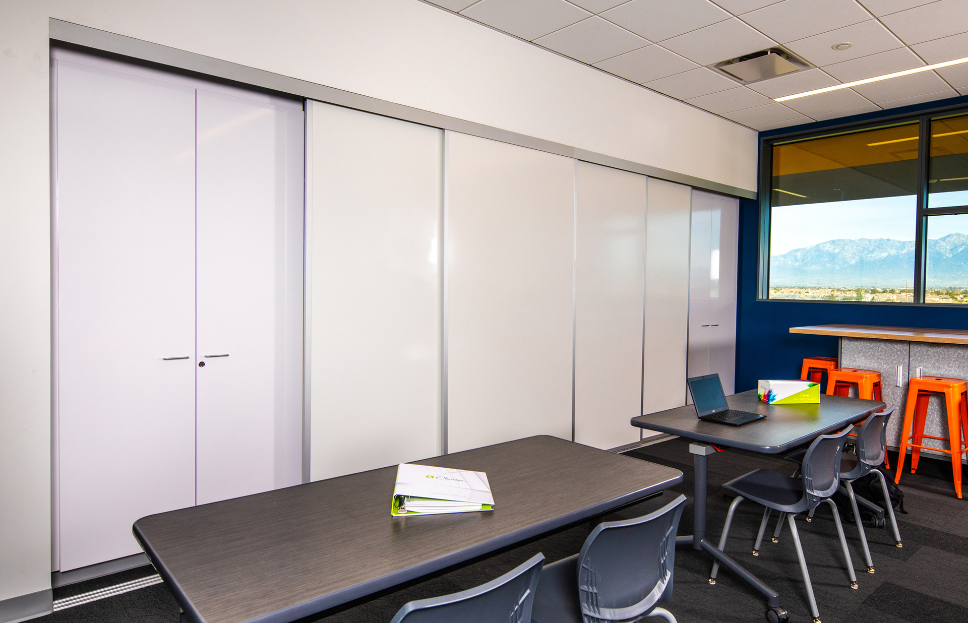 Sliding porcelain sliding doors create a versatile space for work and collaboration between peers and teachers.