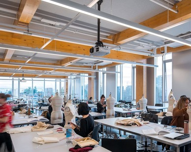 The natural lighting and overhead lighting make a great workspace for the fashion designer students.