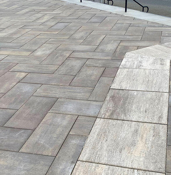 The multi-colored architectural concrete pavers range from gray to brown and provide neutral tones for the walkway.  Combining the beauty of porcelain with the proven performance of Wausau Tile's concrete architectural pavers, Quattro Series proved to be the perfect choice for Florida A&M University's new building.