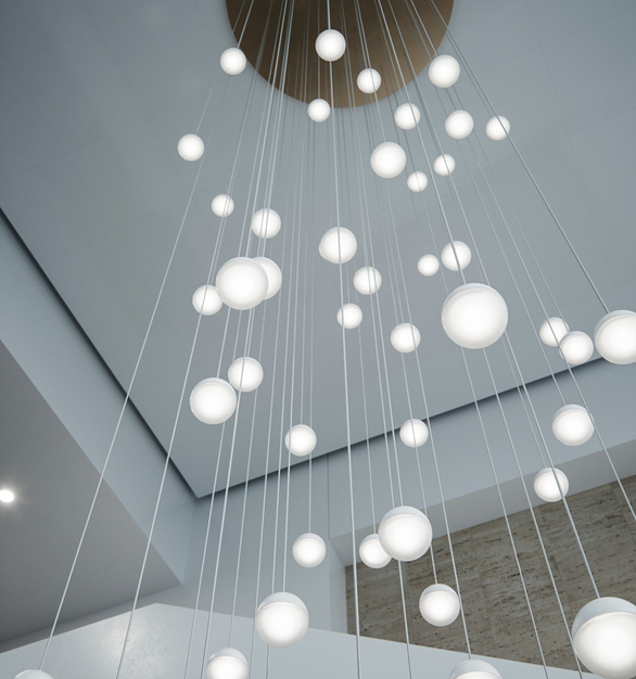 With a robust frosted silicon outer diffuser and acrylic inner diffuser, these sphere shaped hanging pendant lights add style to the lobby area.