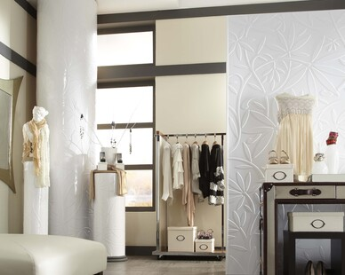 Take a stroll in this beautiful boutique with a focal wall using textured panels.