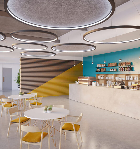 The coffee cafe and lounge area at the offices feature fun, modern seating and Rev Acoustic Pendant lighting. The bright colors and light atmosphere create a lively space.