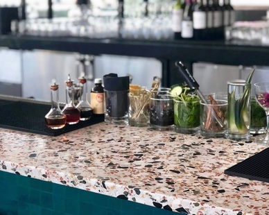 Custom concrete countertops can look any way you'd like. Many colors, patterns, designs. Concrete Collaborative provided the flooring as seen here at this bar.