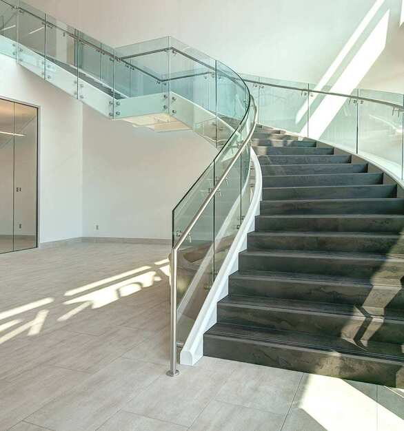 The meeting room near the entrance of the office overlooks the Glasshape TemperShield® staircase.  Maximizing natural light creates work spaces that people enjoy being in. Advances in glass technology have enabled us to provide design solutions such as VisionInk® to vastly extend the applications of this remarkable substrate.