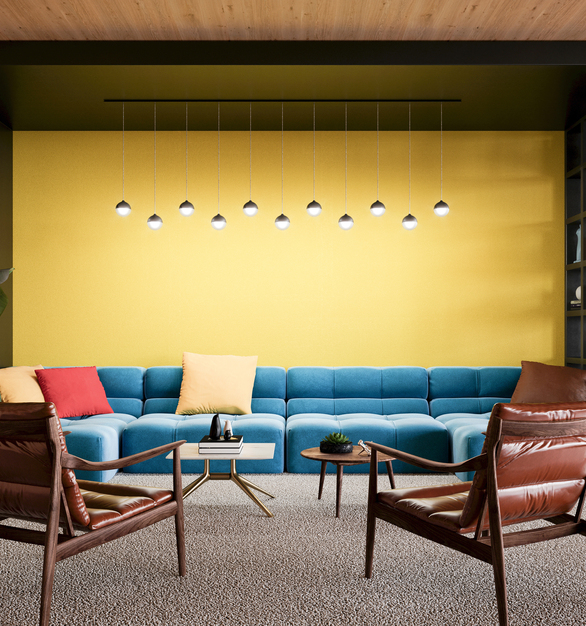 The Glowball Diverge suspended pendant lighting feature a contemporary globe shape and four braided color cord choices. In this office lounge space they provide ample illumination and add to the modern furniture and decor.