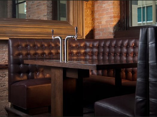 Tufted, leather booth seating created by Contract Industries for Bull and Bear restaurant and bar in downtown Chicago.