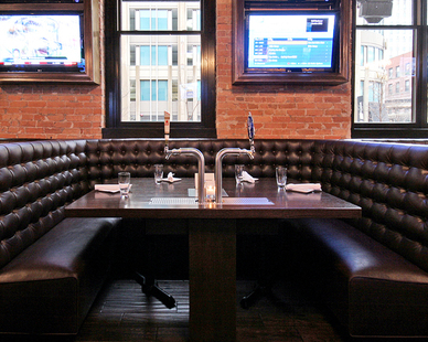 Stunning booth seating provided by Contract Industries for Bull and Bear restaurant in downtown Chicago.