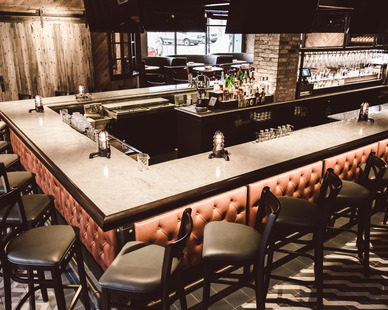 The stunning bar area showcases the custom manufacturing work of Contract Industries.