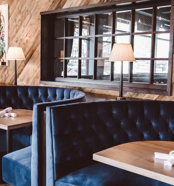 Navy blue custom restaurant booth seating by Contract Industries is a beautiful addition to the dining area at Cadence Kitchen and Co.