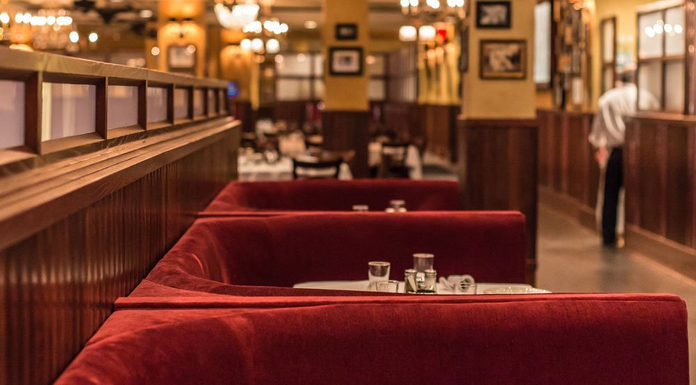 Beautiful booth seating with velvet channel provided by Contract Industries for Carmine's Rosemont, a Rosebud Restaurant.