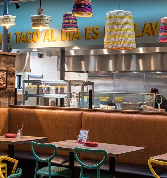 The dining area at Carnitas Uruapan in Chicago showcases the booth seating design by Contract Industries.