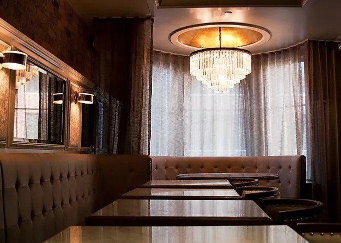 Celeste Chicago is a modern and refined establishment in downtown Chicago. Custom, tufted booth seating was created by Contract Industries.