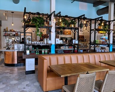 Fairgrounds Coffee and Tea in Wicker Park showcases custom, leather booth seating provided by Contract Industries.