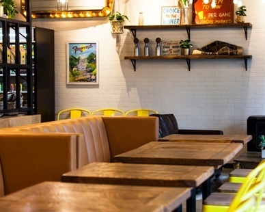 Contract Industries manufactured and installed custom booth seating to the Fairground Coffee and Tea Wicker Park Chicago location.