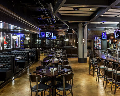 Open bar and dining area at Harey Caray's 7th Inning Stretch in Chicago showcases custom booth's by Contract Industries.