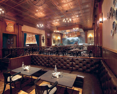 Custom leather, tufted booths were manufactured and installed by Contract Industries.