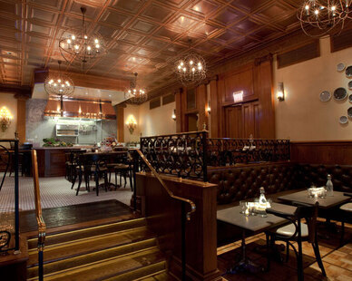 The side door, is what Lawrys in downtown Chicago calls their take out space. It also showcases Contract Industries tufted custom booth seating.