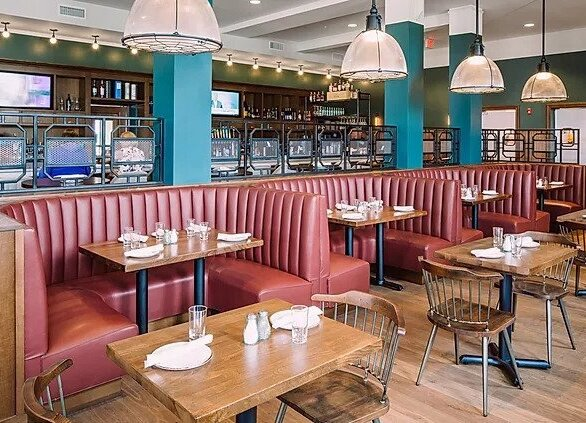 Leeds Public House showcases beautiful and cozy booth seating both manufactured and installed by Contract Industries.