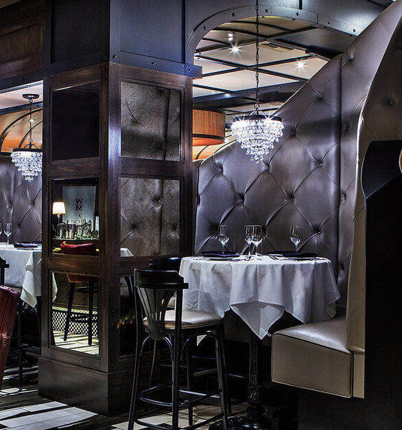 "The ""Green Monster"" is what Contract Industries calls this custom booth seated as a focal point in this spacious steak house."