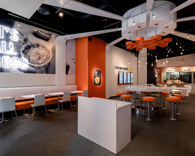 Booth seating along the wall manufactured and installed by Contract Industries for Chicago's River North neighborhood location of Protein Bar.