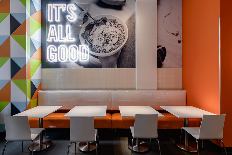 Protein Bar's seating area is custom wall booth seating manufactured and installed by Contract Industries.
