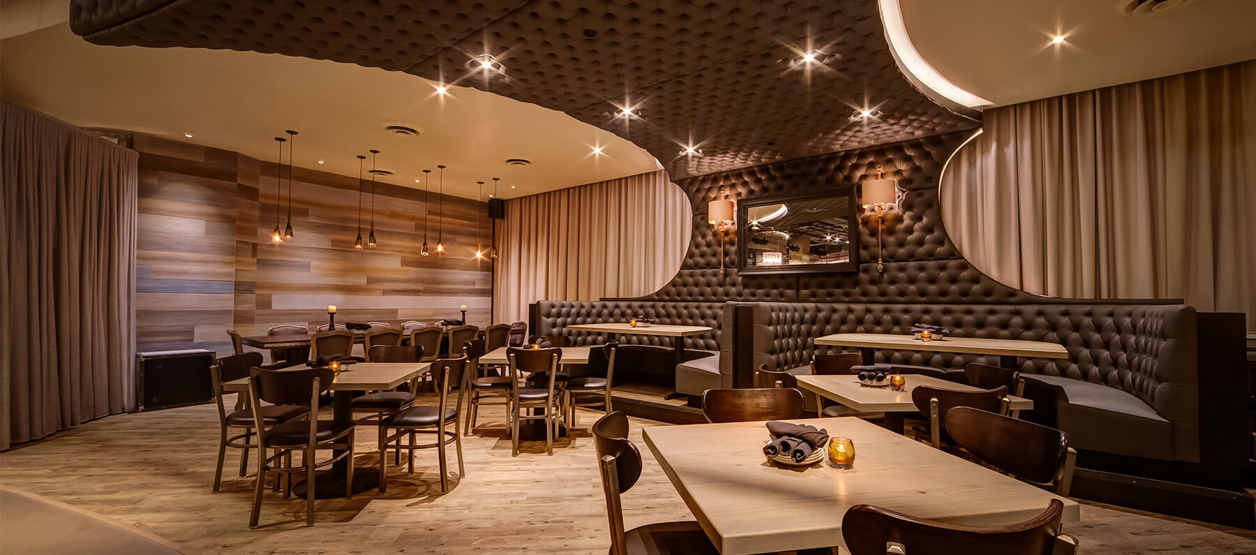 The dining area at Chicago's River North Siena Tavern showcases stunning custom booth seating created by Contract Industries.