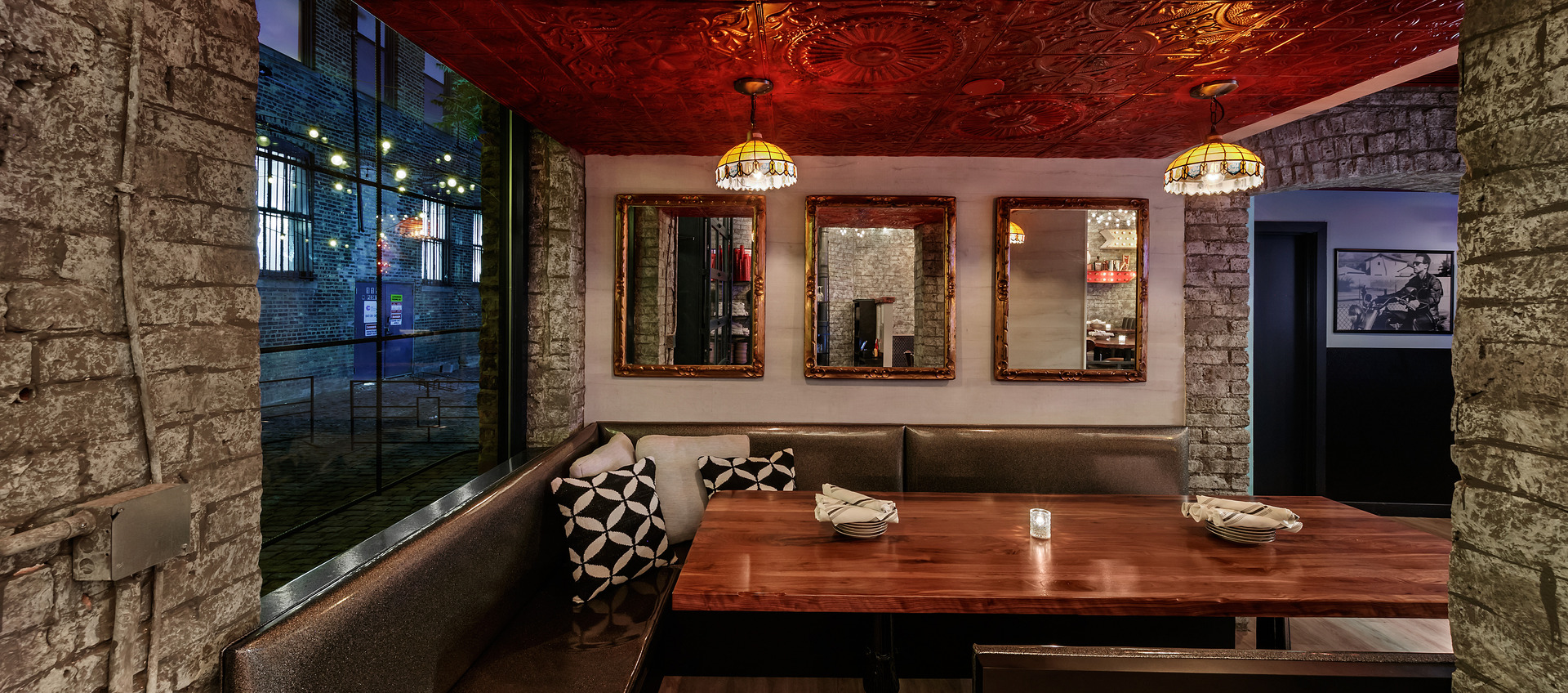 Seen here at The Bandit Chicago, is an intimate seating area with custom booths provided by Custom Industries.