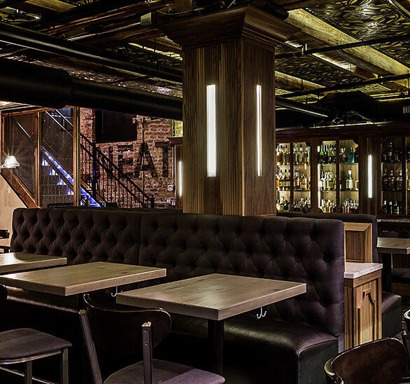 The bar and dining area at The Franklin Room speakeasy showcases the beautifully manufactured custom booth seating by Contract Industries.