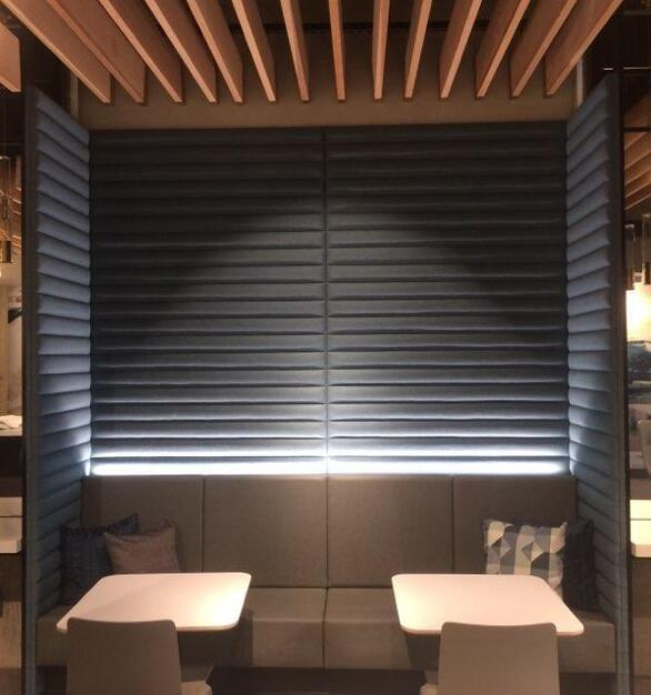 Wooden slat ceiling along with custom amenity booth makes for the perfect space at The Park Evanston in Evanston, Illinois.