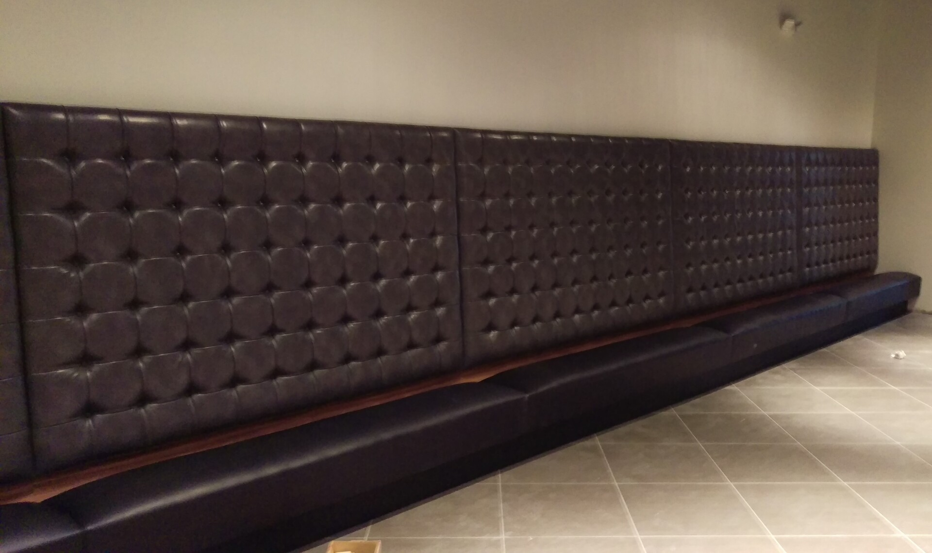Contract Industries created this custom booth seating with a high, tufted back.