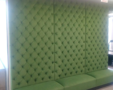A custom, tall booth manufactured and installed by Contract Industries.