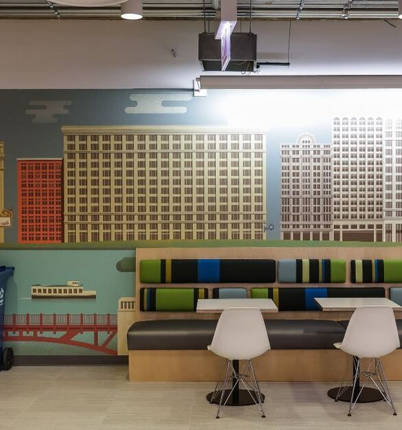Seen here is booth seating with in the work lounge of the Chicago Yelp offices which showcases the custom work from Contract Industries.