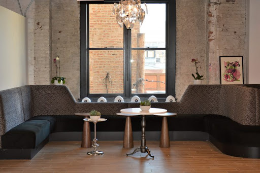 Custom amenity booth seating by Contract Industries can be found at the Chicago offices of iCrossing.