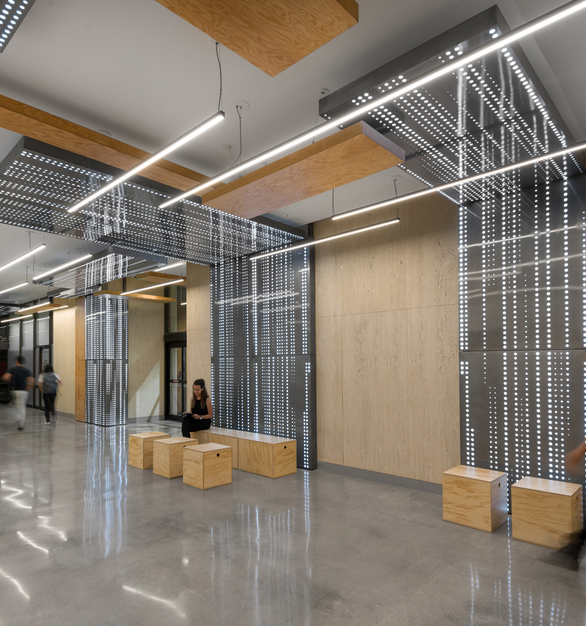 The Burbank Connexion project is a series of high-profile Burbank buildings located in the heart of downtown Burbank. Designed by Patrick Tighe Architecture and illuminated by LEDCONN, the lighting for this architectural space was inspired by an iconic layout of a major Los Angeles freeway.
