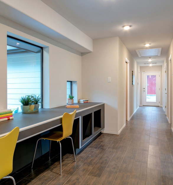 The Habitat for Humanity house built by the Univerisity of Texas at Arlington's School of Architecture features the CAC as trim for the desk and storage area.