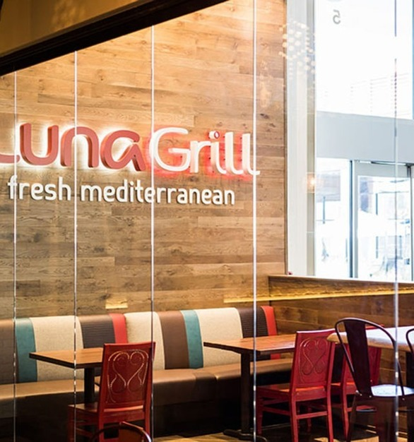 The Luna Grill Mediterranean restaurant features Cover Glass USA's frame-less glass door system.