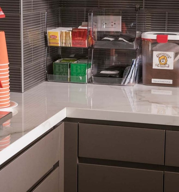 As Epstein employees enjoy the attractive and functional pantry area, they won't have to worry about coffee stains from the inevitable spill or scorch marks from a hot coffee carafe. Now that they have experienced Crossville Porcelain Countertops firsthand, it's exciting to anticipate the many creative client projects that will feature this innovative material in the years to come.