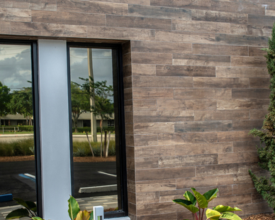 Clad in the nuanced warmth of Crossville's wood-look SpeakEasy, the exterior of this Florida law firm achieved a modern, stand-out style that will last.