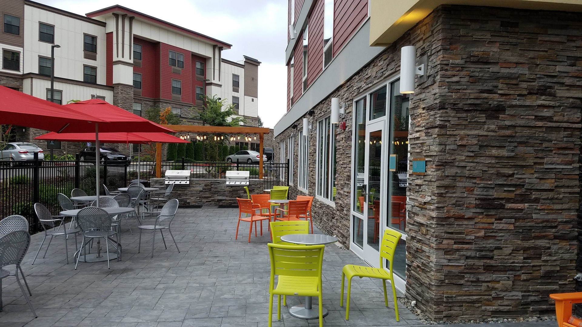 Outdoor patio and dining area can be found at Home2Suites by Hilton.