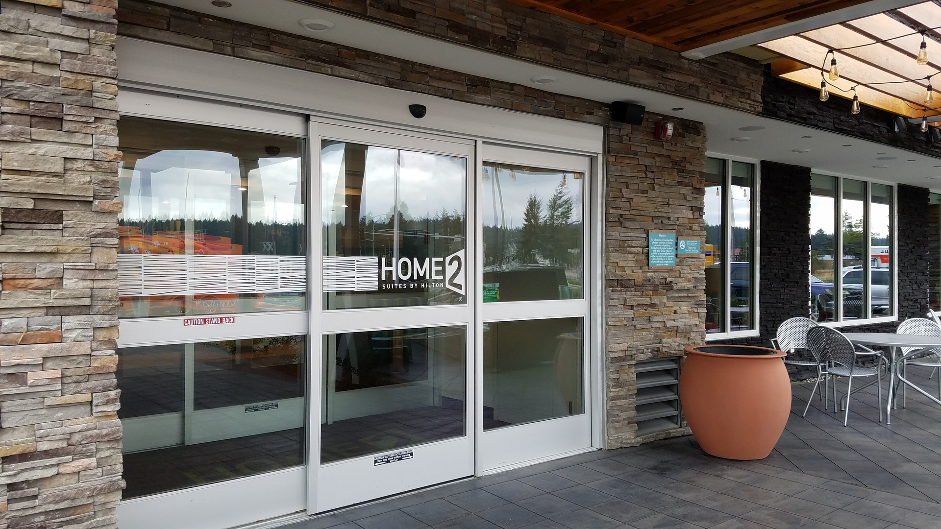 The entrance of Home2Suites by Hilton showcases Pro-Fit® Alpine Ledgestone in Pheasant.