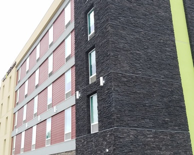 A mix of two Cultured Stone products makes the perfect combination for the exterior of this Home2Suites by Hilton.