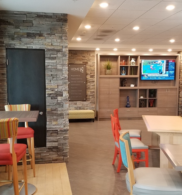 Home2Suites hotel showcases a cozy amenity space for guests consisting of Cultured Stone's Pro-Fit® Alpine Ledgestone in Pheasant.