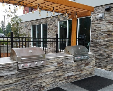 Outdoor grilling area using Cultured Stone's Pro-Fit® Alpine Ledgestone in Pheasant to create a custom space for guests.