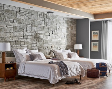 Seen here is a beautiful hotel room design featuring Cultured Stone's sculpted ashlar in silver shore.