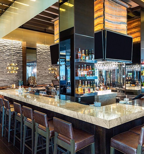 Cultured Stone used its Pro-Fit® Modera™ Ledgestone in the color Carbon for the walls covering this up-scale restaurant in Naples, Florida.
