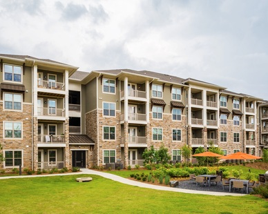 Mixed materials complete the exterior of the luxury apartment complex, Overlook at Huntcrest in Cultured Stone's Country Ledgestone veneer.